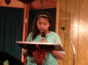 Hailey Phillips reading the Christmas story